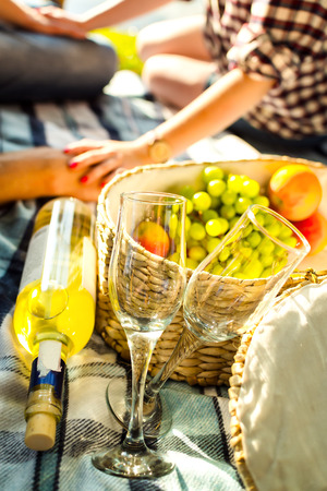 Two glasses, white wine and grapes, picnic theme photo