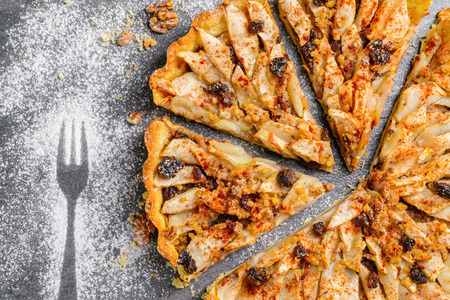 apple tart pie with nuts and raisins photo