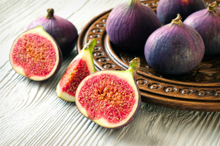 Portion of fresh Figs on wooden background photo