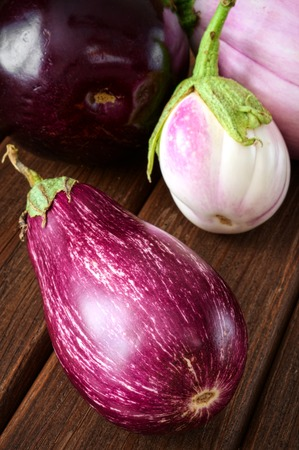 Eggplants Assortment On brown Wooden Background photo