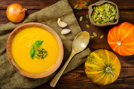 Homemade Autumn Butternut Squash Soup rustic wooden table Фото со стока