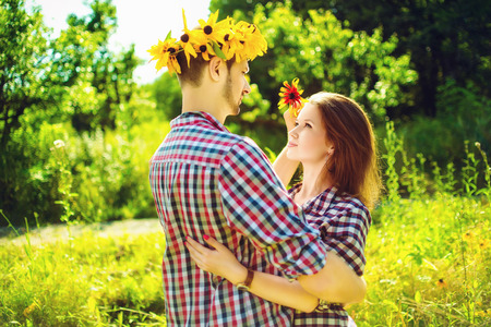 Toned image of young happy couple in love playing romantic game photo