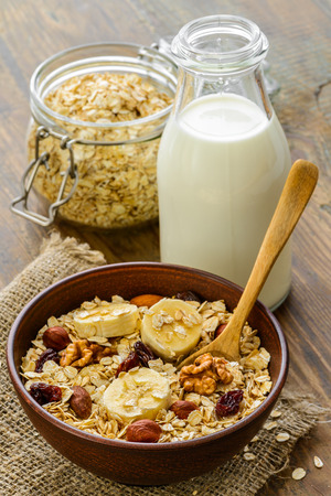 Healthy breakfast - whole grain muesli with a banana and nuts photo