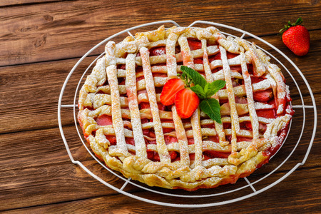 Berry pie. Strawberry tart on rustic wooden table photo