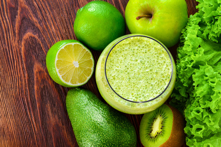 cues: Fresh healthy green smoothie in the glass and ingredients