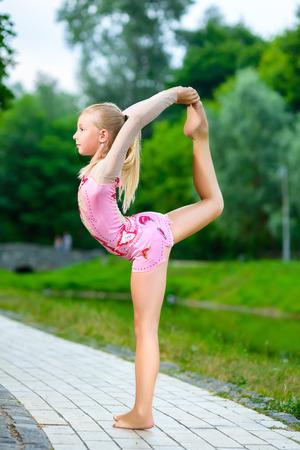 female gymnast: Image of flexible little girl doing gymnastics vertical split