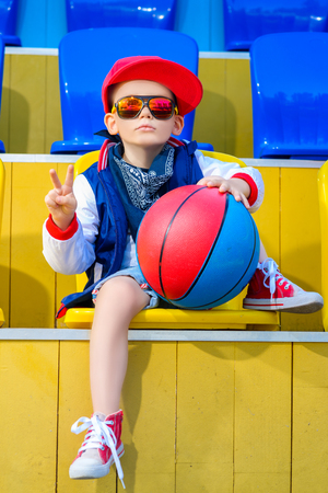 attitude boy: Rapper attitude rap singer hip Hop Dancer performing. Stylish  little boy posing at basketball court.