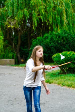 lifestile: Portrait of happy girl holding badminton racket and shuttlecock. Stock Photo