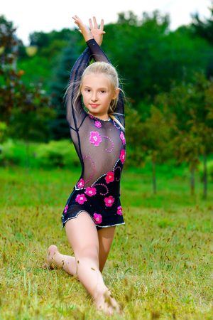 Image of flexible little girl doing gymnastics split