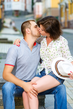 hot guy: Happy young couple in love kissing at city Stock Photo