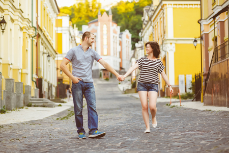 hot guy: Happy couple in love walking at city.