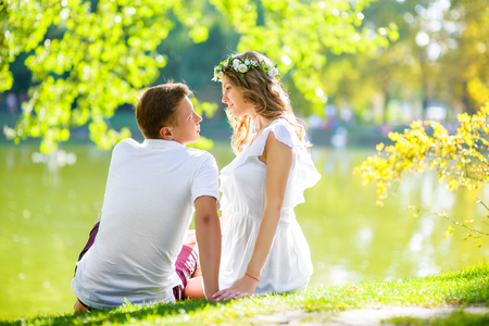 young love: happy young couple enjoying holidays at the lake. and have good time on summer vacations