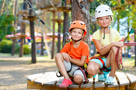 Young boy and girl playing when having fun doing activities outdoors. Happy childhood concept. Standard-Bild