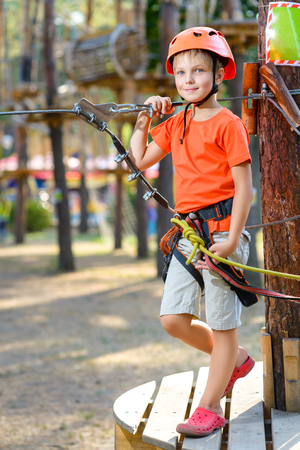 jungle boy: Young boy playing and having fun doing activities outdoors. Happiness and happy childhood concept. Stock Photo