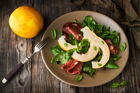 Concept of italian food with melon and prosciutto Stockfoto
