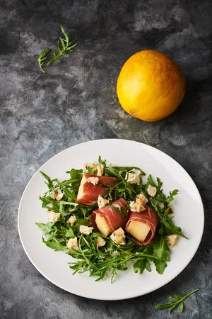 Concept of italian food with arugula, prosciutto, and melon salad Stockfoto