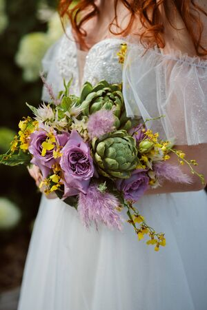 closeup photo Bride hands holding wedding bouquet