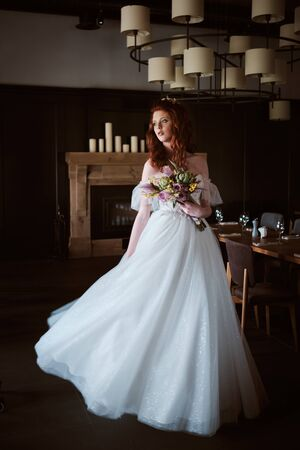 portrait of Stunning young fashionable bride holding bouquet