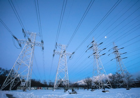 Electricity pylons and power high voltage power tower in winter evening Stok Fotoğraf