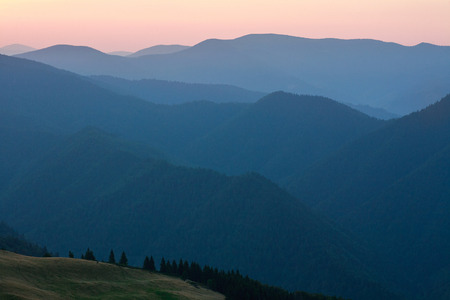 dawn sky: Mountain forest on a ridge at dawn sky background Archivio Fotografico