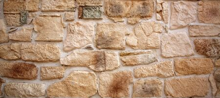 Ancient stone old wall background, antique textured exterior