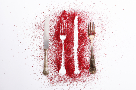 Seasonings dissolved on a white background. Stencil forks and knife on a white background. Banco de Imagens