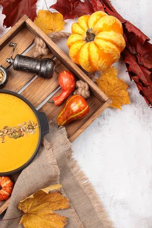 Plate with pumpkin soup. Autumn menu in the restaurant. View from above. Copy space.