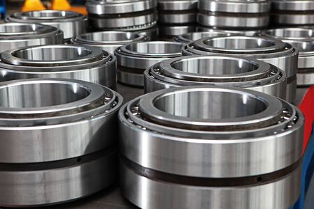 Manufacture of bearings in the factory.The chrome surface of products. Industrial theme. Production of bearings. Out of focus