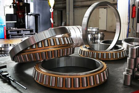 Manufacture of bearings in the factory.The chrome surface of products. Industrial theme. Production of bearings. Photos on the factory's territory 版權商用圖片