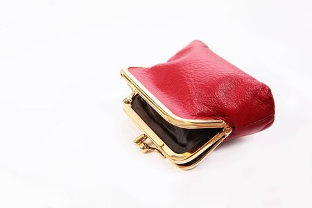 Red wallet without money on a white background. An isolated object. Copy space. The concept financial crisis. Top view.
