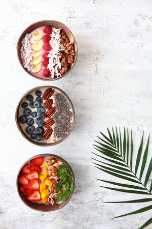 Balinese-style breakfasts. Muesli with yogurt and berries in plates made of coconut skin. Wholesome breakfast. Top view. Copy space. Stock fotó