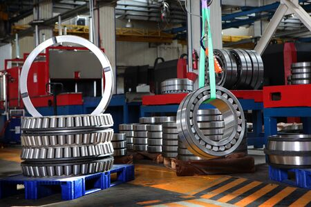 Bearing manufacture. Heavy industry. Metal products. Copy space. Photos in the premises of the plant.