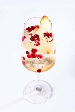 Cranberry and pear lemonade. Soft drink. Summer season. Isolated object. Copy space. 免版税图像