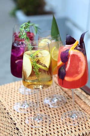 Assorted lemonades in tall glasses. Vertical photo. 免版税图像