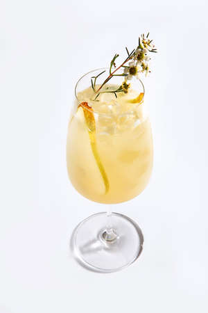 Lemonade from ripe pears in a tall glass on a white background. Copy of the space. An isolated object.Top view.