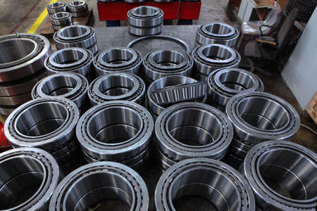 A large number of bearings. Finished products at the bearing plant. Top view. Copy space.