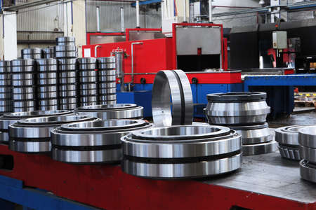 A large number of ready-made bearings in the factory. Finished products of the bearing plant. Heavy industry concept. Metal products.