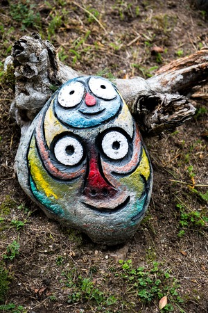 sculpture: Funny painted rock sculpture in Italy forest