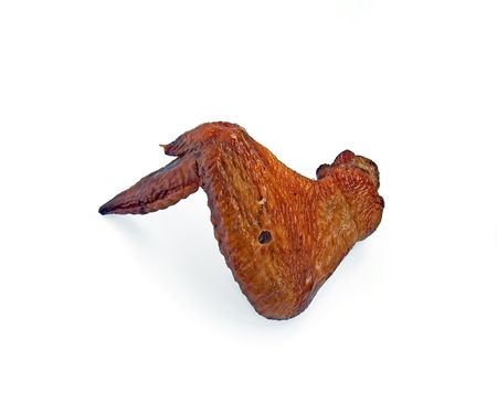 Smoked chicken wing on a white background photo