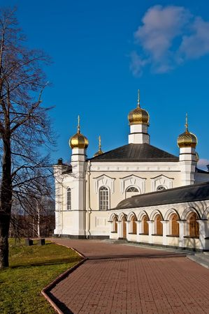 righteous: Temple of Simeon the Righteous with gold baths, part of the gallery, trees against the blue sky (Simeon Compound Novo Tikhvinsky nunnery in with. Merkushino Verkhotursk district, Sverdlovsk region) Stock Photo