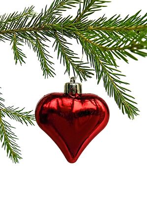 Christmas Toy in the form of heart on the green fir branch isolated on white background Stock Photo - 8219049