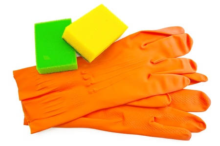 Orange rubber gloves, two sponges of green and yellow colors isolated on white background photo