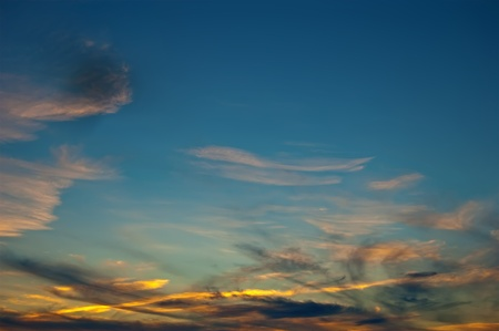 reveille: Sunrise, clouds, painted in red and orange against the blue sky