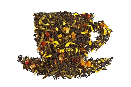 A mixture of black and green dry tea with petals of sunflower, rose, fruit of rose hips and papaya in form cup isolated on a white background photo