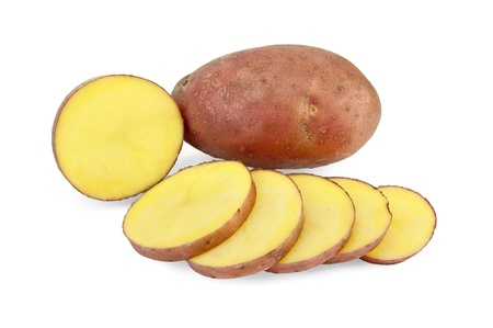 One whole and one sliced potato into slices isolated on white background photo