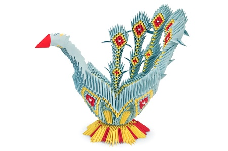 Origami in the form of yellow, blue and red bird with iridescent tail is isolated on a white background photo