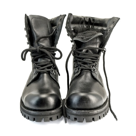 combat boots: A pair of high black leather boots isolated on white background