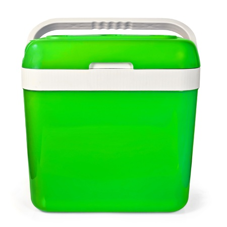 Green small portable refrigerator for traveling in the car isolated on white background photo