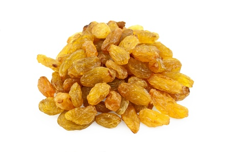 Heap of yellow seedless raisins isolated on white background photo