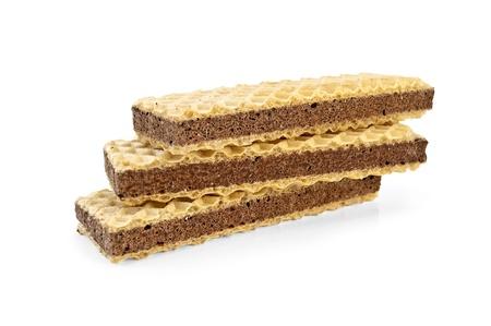 A stack of waffles, chocolate interlayered isolated on white background photo